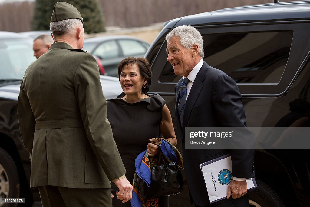 New Secretary of Defense Chuck Hagel and his wife Lilibet Hagel are greeted by USMC Lt. General Thomas Waldhauser, who will serve as Hagel's Senior Private Military Assistant, as they arrive for his first day at the Department of Defense, on February 27, 2013 in Arlington. Hagel will be sworn in Wednesday morning and deliver remarks to service members and employees later in the day.