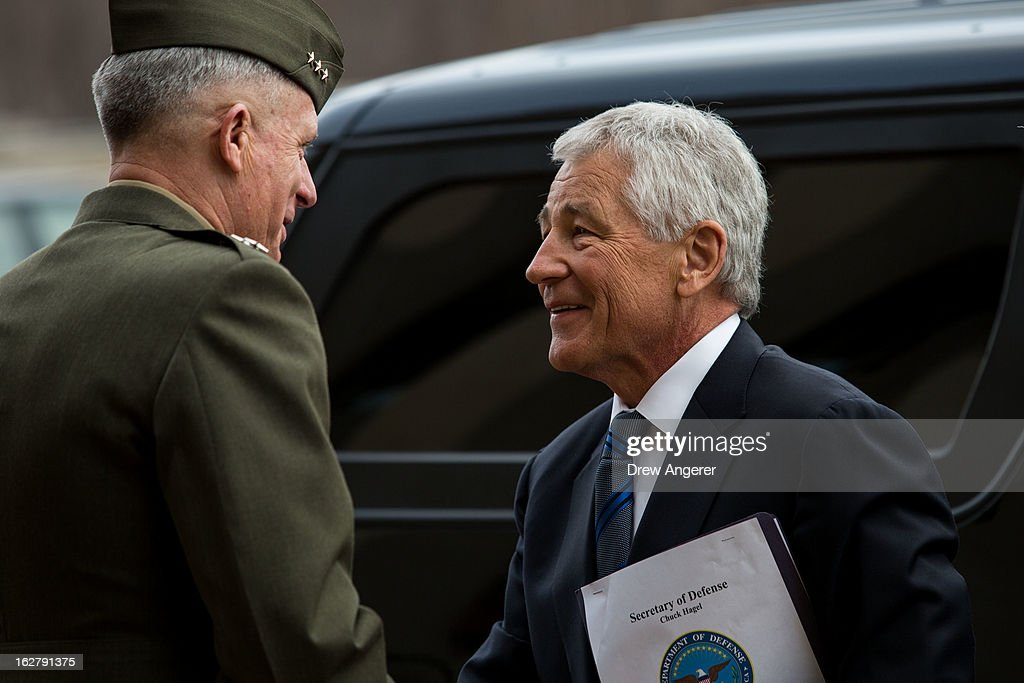 New Secretary of Defense Chuck Hagel is greeted by USMC Lt. General Thomas Waldhauser, who will serve as Hagel's Senior Private Military Assistant, as he arrives for his first day at the Department of Defense, on February 27, 2013 in Arlington. Hagel will be sworn in Wednesday morning and deliver remarks to service members and employees later in the day.