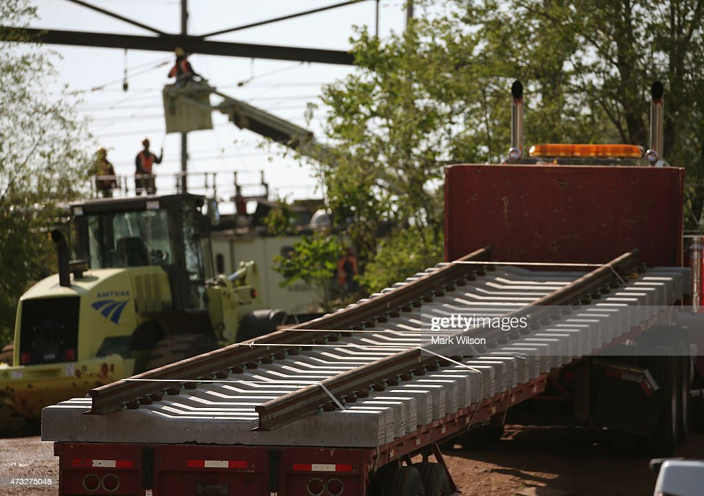 New sections of track is trucked in after an Amtrak train derailment May 14 2015 in Philadelphia Pennsylvania Service has been interrupted after an...