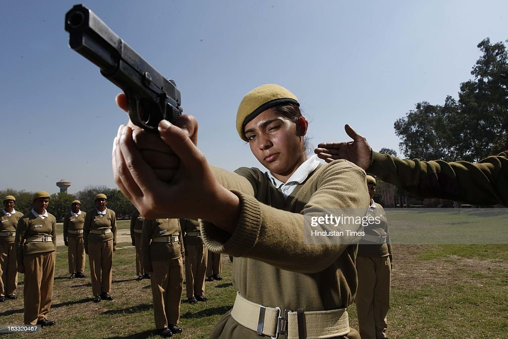 New selected Delhi Police (DP) woman personnel Meenu, 21, on training at PTC, Jharoda Kalan on March 7, 2013 in New Delhi, India. Meenu is daughter of Late Head Constable Vijender Singh of Delhi Police, who died in July 2011 while on duty. Delhi Police selected 37 women constables whose kin were died while on duty for Delhi Police.