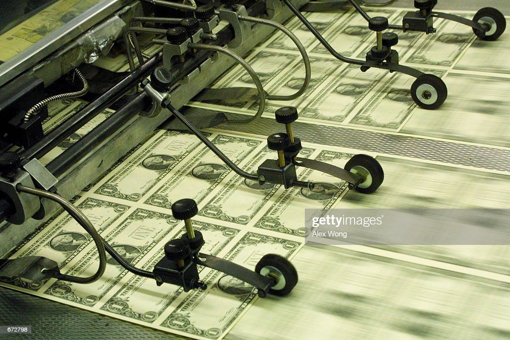 New Series 2001 one dollar bill notes pass through a printing press November 21, 2001 at the Bureau of Engraving and Printing in Washington, DC. The new dollar bills contain the signatures of U.S. Treasury Secretary Paul O''Neill and U.S. Treasurer Rosario Marin.