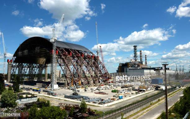 A new shelter that is to blanket the decrepit sarcophagus covering the No4 reactor is under construction at Chernobyl Nuclear Power Plant on June 19...