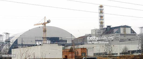 A new shelter that is to blanket the decrepit sarcophagus covering the No4 reactor is under construction at Chernobyl Nuclear Power Plant on February...