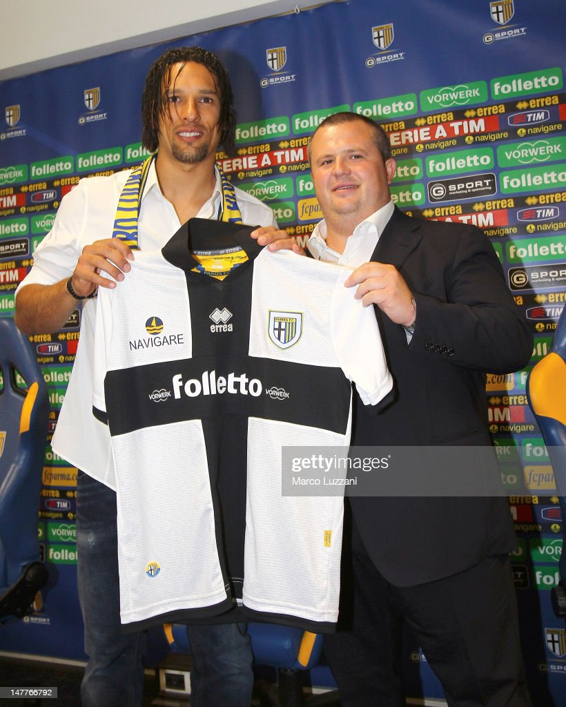 New signing Amauri Carvalho de Oliveira and president of Parma FC Tommaso Ghirardi present the new team shirt during a press conference at Stadio...