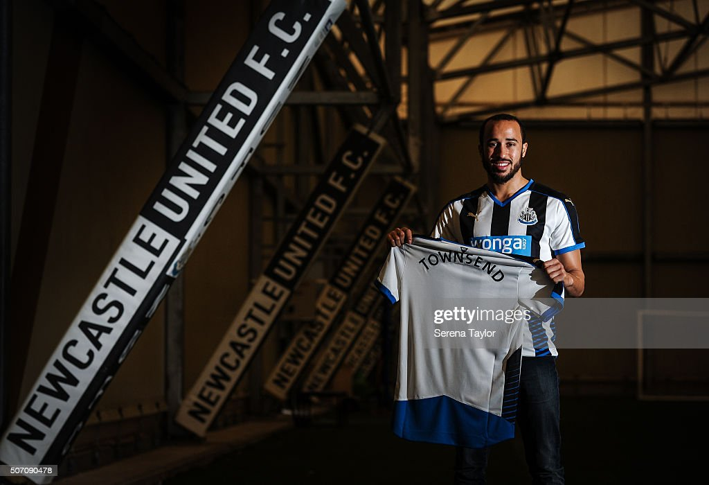 New Signing <a gi-track='captionPersonalityLinkClicked' href=/galleries/search?phrase=Andros+Townsend&family=editorial&specificpeople=4266573 ng-click='$event.stopPropagation()'>Andros Townsend</a> poses for photographs holding a Newcastle United Named Shirt on the indoor training pitch at The Newcastle United Training Centre on January 27, 2016, in Newcastle upon Tyne, England.
