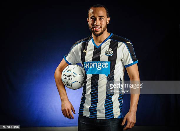 New Signing Andros Townsend poses for photographs holding a Newcastle United Football at The Newcastle United Training Centre on January 27 in...