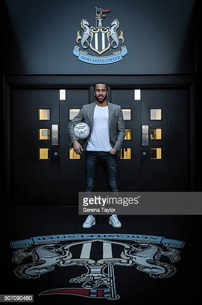 New Signing Andros Townsend poses for photographs in the directors box holding a Newcastle Football at StJames' Park on January 27 in Newcastle upon...