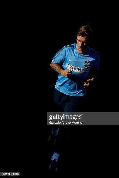 New signing Antoine Griezmann of Atletico de Madrid excercises during the Club Atletico de Madrid training session at Cerro del Espino Sport City on...