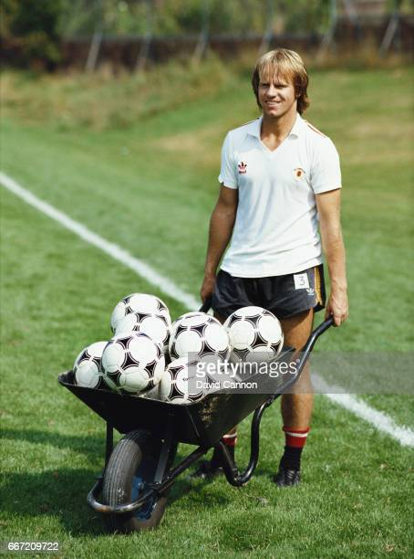New Signing Arthur Graham pictured with a wheelbarrow full of Adidas Tango Footballs after his transfer to the club from Leeds United in August 1983