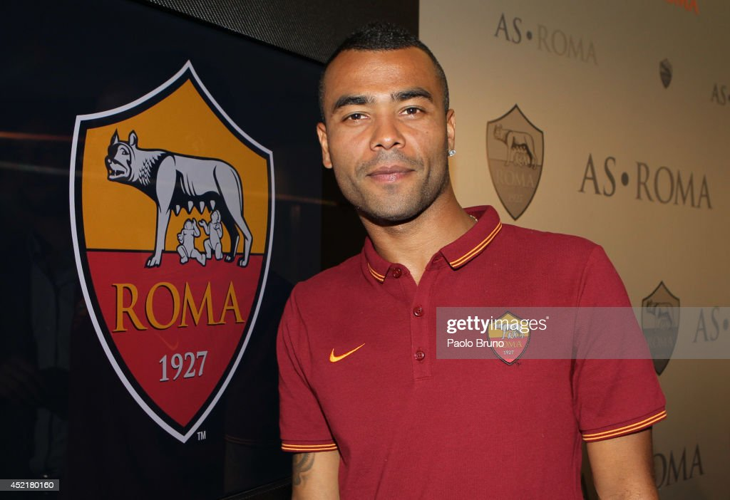 New signing Ashley Cole poses for photographs during the press conference at the AS Roma Training Centre on July 15 2014 in Rome Italy