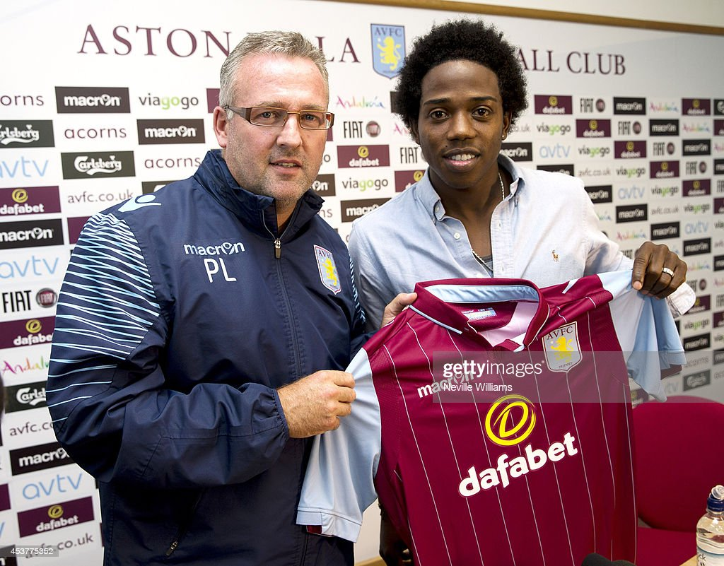 New signing Carlos Sanchez (L) of Aston Villa poses for a photo with his new team's shirt and Paul Lambert, manager of Aston Villa at the club's training ground at Bodymoor Heath on August 18, 2014 in Birmingham, England.