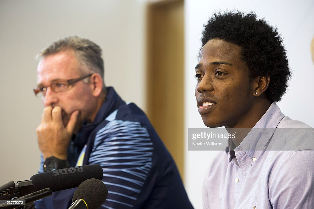 New signing Carlos Sanchez (R) of Aston Villa talks to the press with Paul Lambert, manager of Aston Villa at the club's training ground at Bodymoor Heath on August 18, 2014 in Birmingham, England.