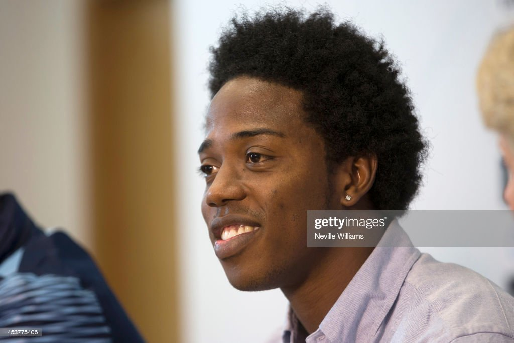 New signing Carlos Sanchez of Aston Villa talks to the press with Paul Lambert, manager of Aston Villa (not pictured) at the club's training ground at Bodymoor Heath on August 18, 2014 in Birmingham, England.