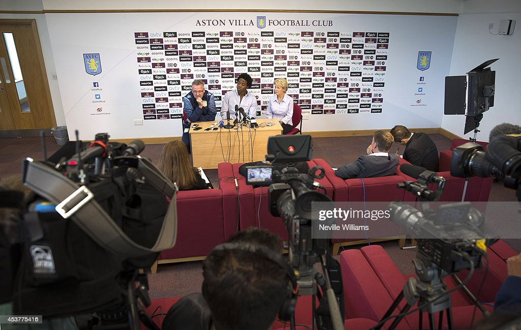 New signing Carlos Sanchez (C) of Aston Villa talks to the press with Paul Lambert (R), manager of Aston Villa at the club's training ground at Bodymoor Heath on August 18, 2014 in Birmingham, England.