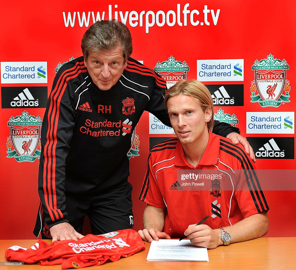 New signing <a gi-track='captionPersonalityLinkClicked' href=/galleries/search?phrase=Christian+Poulsen&family=editorial&specificpeople=228068 ng-click='$event.stopPropagation()'>Christian Poulsen</a> of Liverpool singns a three year deal with <a gi-track='captionPersonalityLinkClicked' href=/galleries/search?phrase=Roy+Hodgson&family=editorial&specificpeople=881703 ng-click='$event.stopPropagation()'>Roy Hodgson</a> manager of Liverpool at Melwood training ground on August 12, 2010 in Liverpool, England.