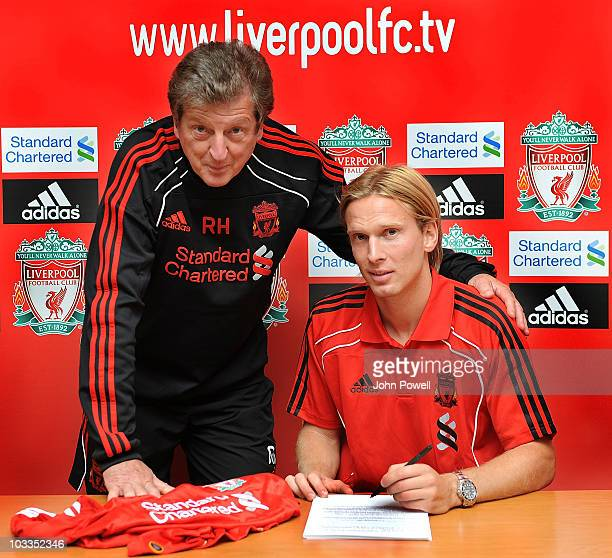 New signing Christian Poulsen of Liverpool singns a three year deal with Roy Hodgson manager of Liverpool at Melwood training ground on August 12...