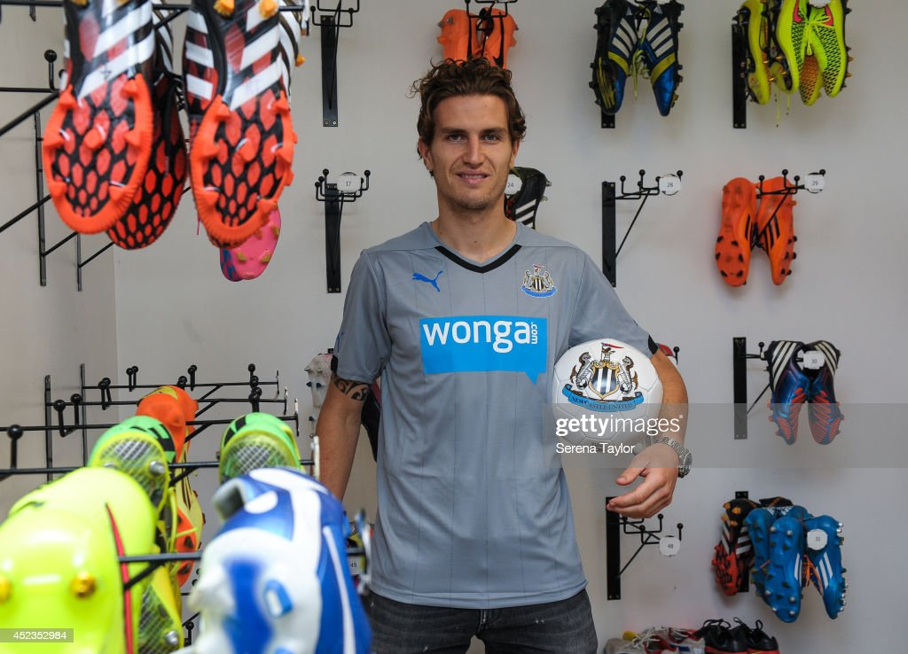 New signing Daryl Janmaat poses for photographs holding a ball in the boot room at the Newcastle United Training Centre on July 15 2014 in Newcastle...