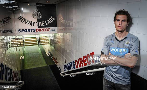 New signing Daryl Janmaat poses for photographs in the tunnel at StJames' Park on July 15 2014 in Newcastle upon Tyne England