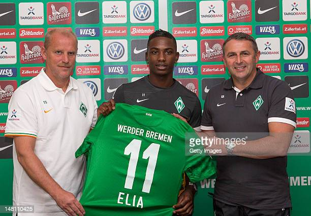 New signing Eljero Elia of Werder Bremen poses for photographs with their Head Coach Thomas Schaaf and Director of Sport Klaus Allofs during a Werder...