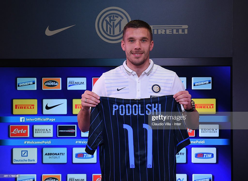 New signing for FC Internazionale <a gi-track='captionPersonalityLinkClicked' href=/galleries/search?phrase=Lukas+Podolski&family=editorial&specificpeople=204460 ng-click='$event.stopPropagation()'>Lukas Podolski</a> poses during a press conference at Appiano Gentile on January 8, 2015 in Como, Italy.