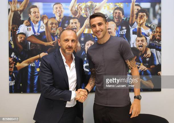 New signing for FC Internazionale Milano Matias Vecino shakes hands with Sportif Director of FC Internazionale Milano Piero Ausilio at FC...