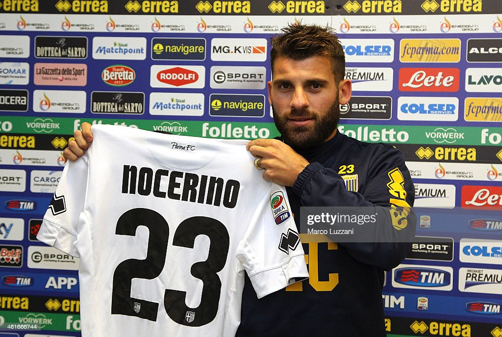 New signing for Parma FC <a gi-track='captionPersonalityLinkClicked' href=/galleries/search?phrase=Antonio+Nocerino&family=editorial&specificpeople=675969 ng-click='$event.stopPropagation()'>Antonio Nocerino</a> poses with the club shirt during press conference at the club's training ground on January 17, 2015 in Collecchio, Italy.