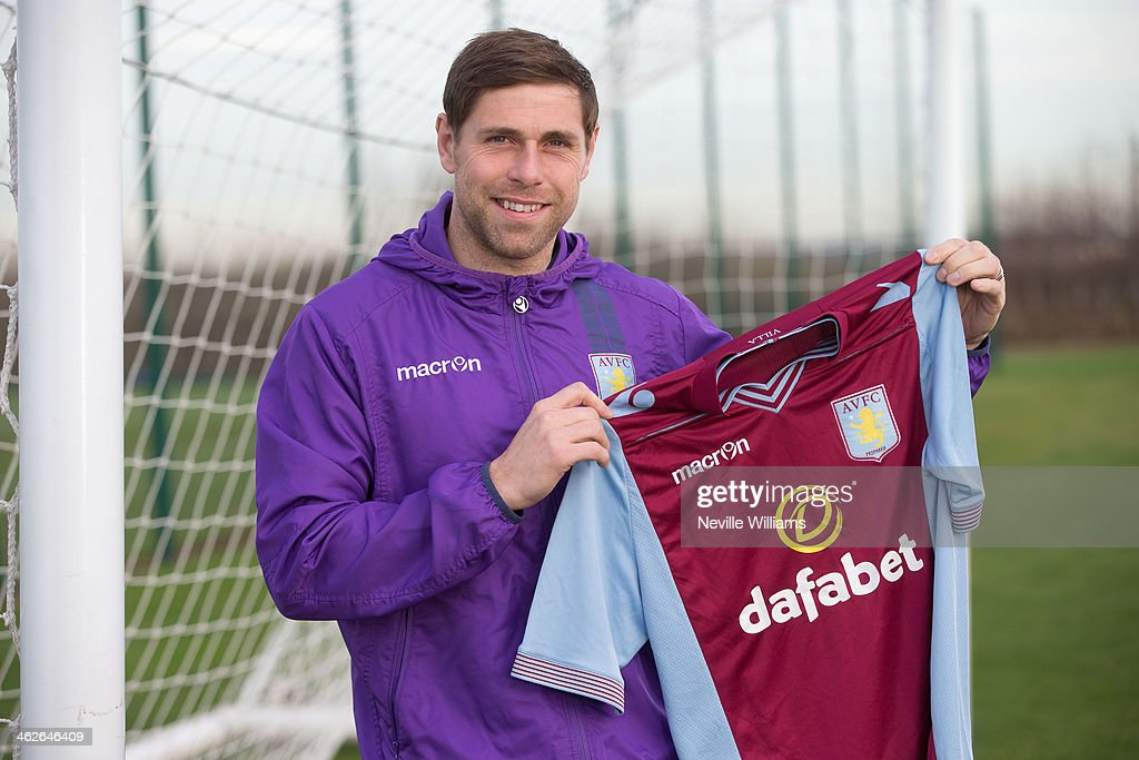 New signing <a gi-track='captionPersonalityLinkClicked' href=/galleries/search?phrase=Grant+Holt&family=editorial&specificpeople=2091078 ng-click='$event.stopPropagation()'>Grant Holt</a> of Aston Villa poses for a picture at the club's training ground at Bodymoor Heath on January 14, 2014 in Birmingham, England.