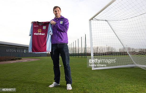 New signing Grant Holt of Aston Villa poses for a picture at the club's training ground at Bodymoor Heath on January 14 2014 in Birmingham England