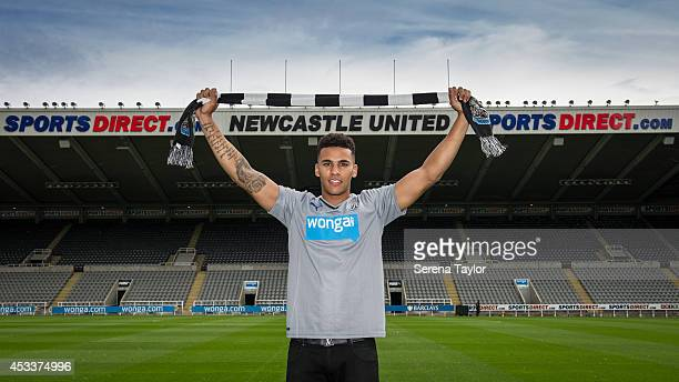 New signing Jamaal Lascelles poses for photographs pitch side at StJames' Park holding a Newcastle United scarf on August 05 2014 in Newcastle upon...