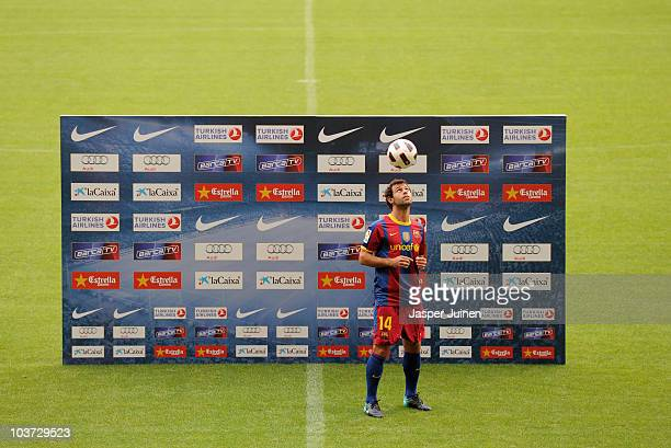 New signing Javier Mascherano heads a ball during his presentation as new Barcelona player at the Camp Nou stadium on August 30 2010 in Barcelona...