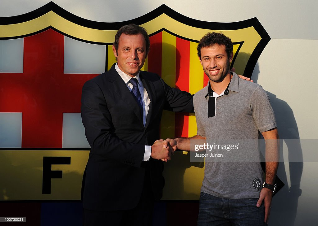 New signing <a gi-track='captionPersonalityLinkClicked' href=/galleries/search?phrase=Javier+Mascherano&family=editorial&specificpeople=490876 ng-click='$event.stopPropagation()'>Javier Mascherano</a> (R) poses with the president of FC Barcelona <a gi-track='captionPersonalityLinkClicked' href=/galleries/search?phrase=Sandro+Rosell&family=editorial&specificpeople=2363208 ng-click='$event.stopPropagation()'>Sandro Rosell</a> during his presentation as new Barcelona player at the Camp Nou stadium on August 30, 2010 in Barcelona, Spain.