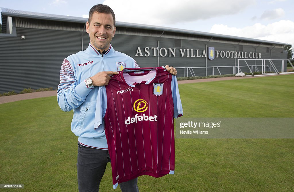 New signing <a gi-track='captionPersonalityLinkClicked' href=/galleries/search?phrase=Joe+Cole&family=editorial&specificpeople=171525 ng-click='$event.stopPropagation()'>Joe Cole</a> of Aston Villa poses for a picture at the club's training ground at Bodymoor Heath on June 10, 2014 in Birmingham, England.