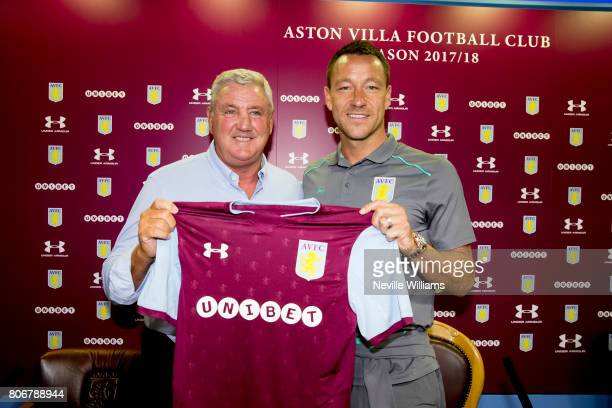 New signing John Terry of Aston Villa and Steve Bruce manager of Aston Villa pose for a picture at Villa Park on July 03 2017 in Birmingham England