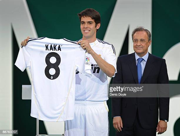 New signing Kaka presents his new Real Madrid shirt beside club President Florentino Perez during his official presentation as a Real Madrid player...