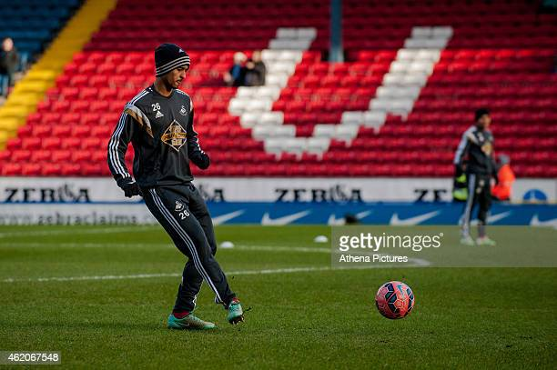 New signing Kyle Naughton of Swansea City warms up during the FA Cup Fourth Round match between Blackburn Rovers and Swansea City at Ewood park on...