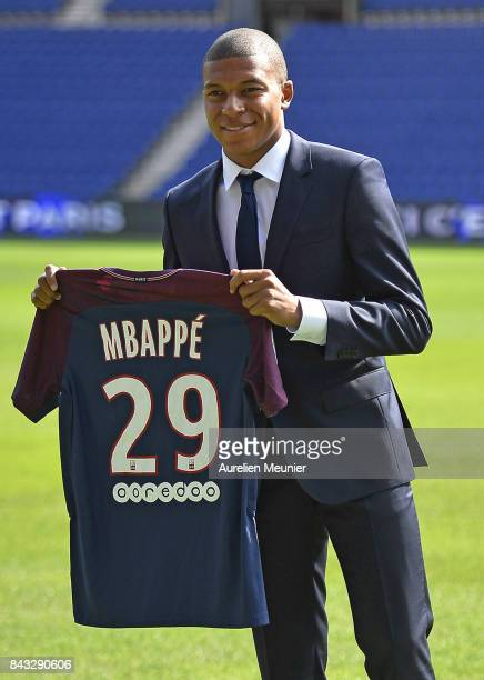 New signing Kylian Mbappe of Paris SaintGermain poses for the media at the Parc des Princes on September 6 2017 in Paris France Kylian Mbappe signed...