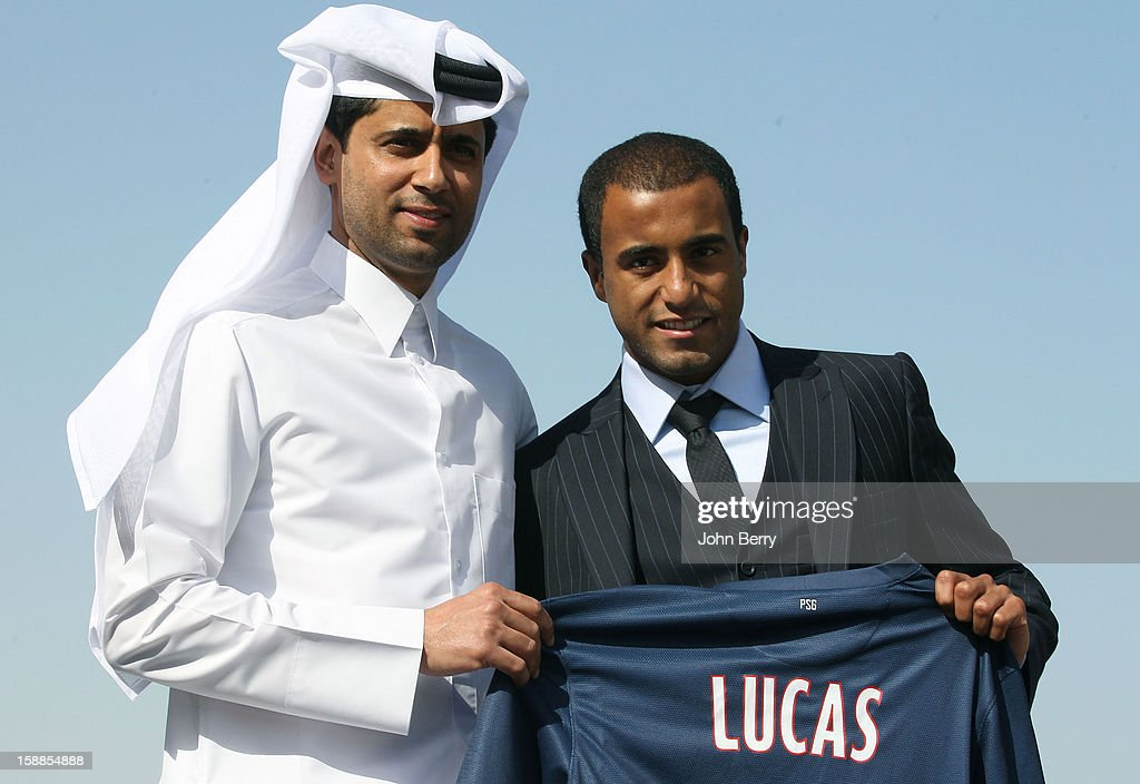 New signing <a gi-track='captionPersonalityLinkClicked' href=/galleries/search?phrase=Lucas+Moura+-+Milieu+offensif+et+ailier+n%C3%A9+en+1992&family=editorial&specificpeople=7910925 ng-click='$event.stopPropagation()'>Lucas Moura</a> of PSG poses with <a gi-track='captionPersonalityLinkClicked' href=/galleries/search?phrase=Nasser+Al-Khelaifi&family=editorial&specificpeople=7941556 ng-click='$event.stopPropagation()'>Nasser Al-Khelaifi</a>, president of PSG, during his offical unveiling as a player of Paris Saint-Germain at a press conference and a jersey presentation at the Museum of Islamic Art on January 1, 2013 in Doha, Qatar.