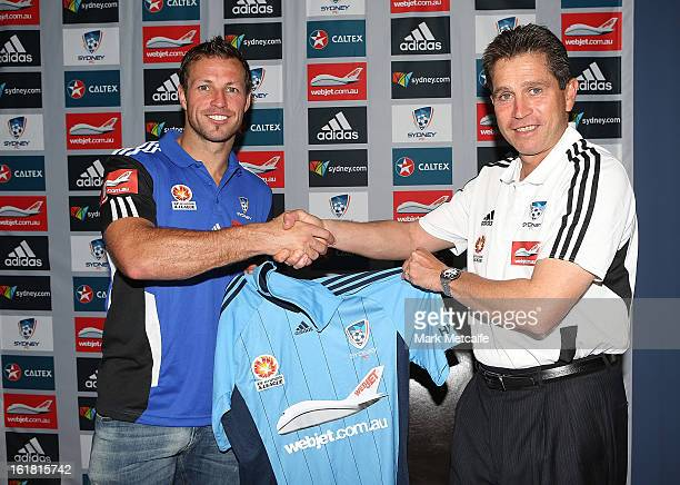New signing Lucas Neill is presented with a Sydney FC jersey by Coach Frank Farina during a Sydney FC press conference at Macquarie Uni on February...