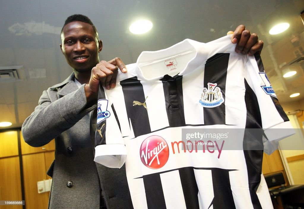 New signing Mapou Yanga-Mbiwa of Newcastle United poses with the club shirt at the Little Benton training ground on January 22, 2013 in Newcastle upon Tyne, England.