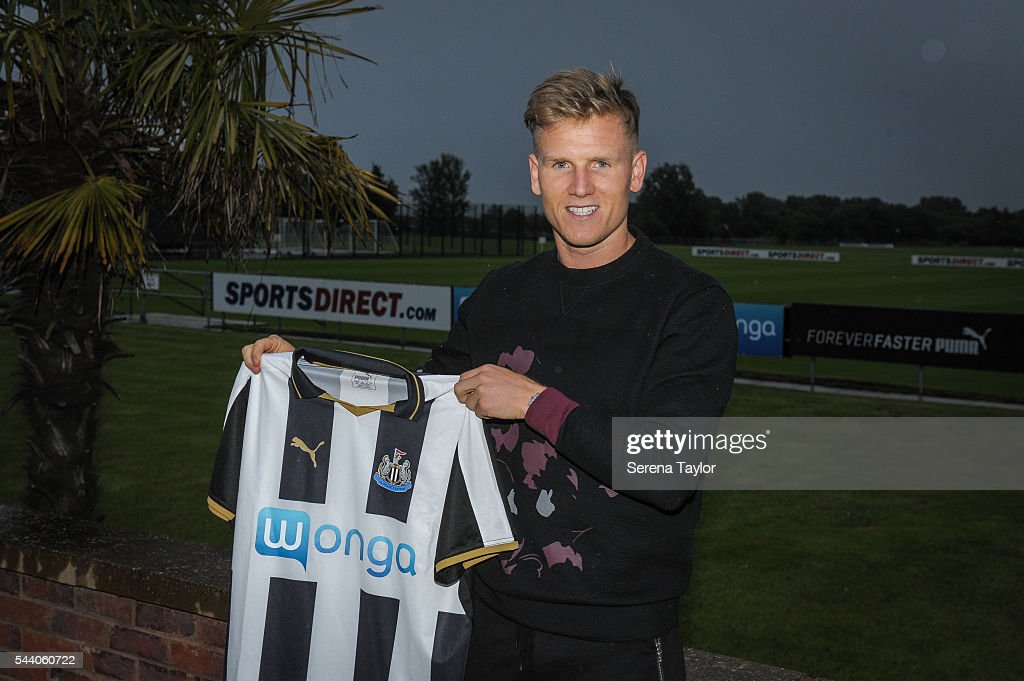 New signing Matt Ritchie holds the new NUFC 2015/16 shirt at The Newcastle United Training Centre on July 1, 2016 in Newcastle upon Tyne, England.