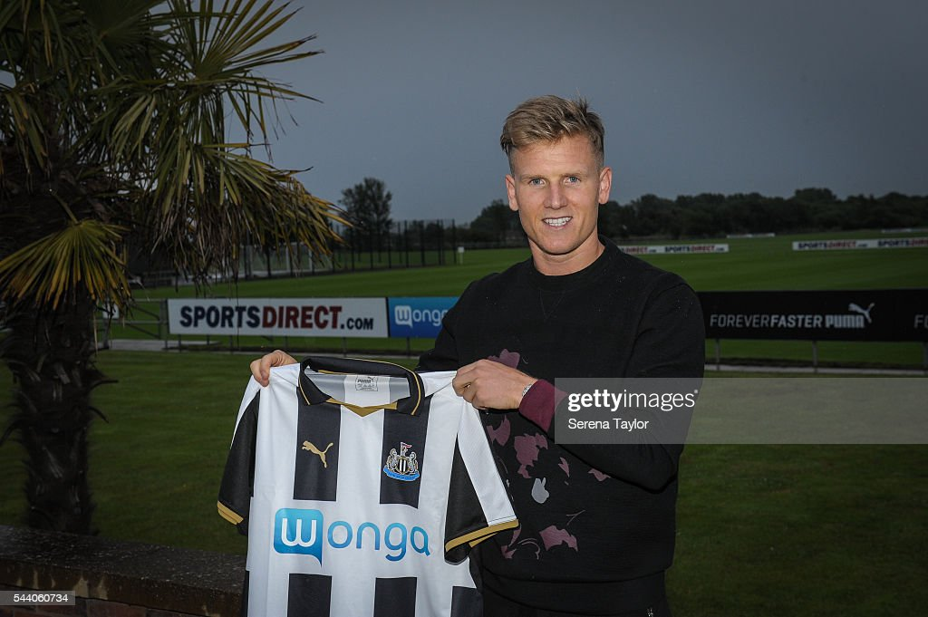 New signing <a gi-track='captionPersonalityLinkClicked' href=/galleries/search?phrase=Matt+Ritchie+-+Soccer+Player&family=editorial&specificpeople=5672743 ng-click='$event.stopPropagation()'>Matt Ritchie</a> holds the new NUFC 2015/16 shirt at The Newcastle United Training Centre on July 1, 2016 in Newcastle upon Tyne, England.