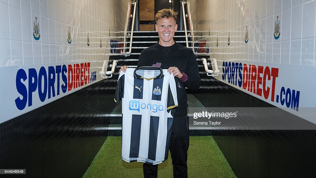 New signing <a gi-track='captionPersonalityLinkClicked' href=/galleries/search?phrase=Matt+Ritchie+-+Soccer+Player&family=editorial&specificpeople=5672743 ng-click='$event.stopPropagation()'>Matt Ritchie</a> holds the new NUFC 2015/16 shirt in the tunnel at St.James' Park on July 1, 2016 in Newcastle upon Tyne, England.