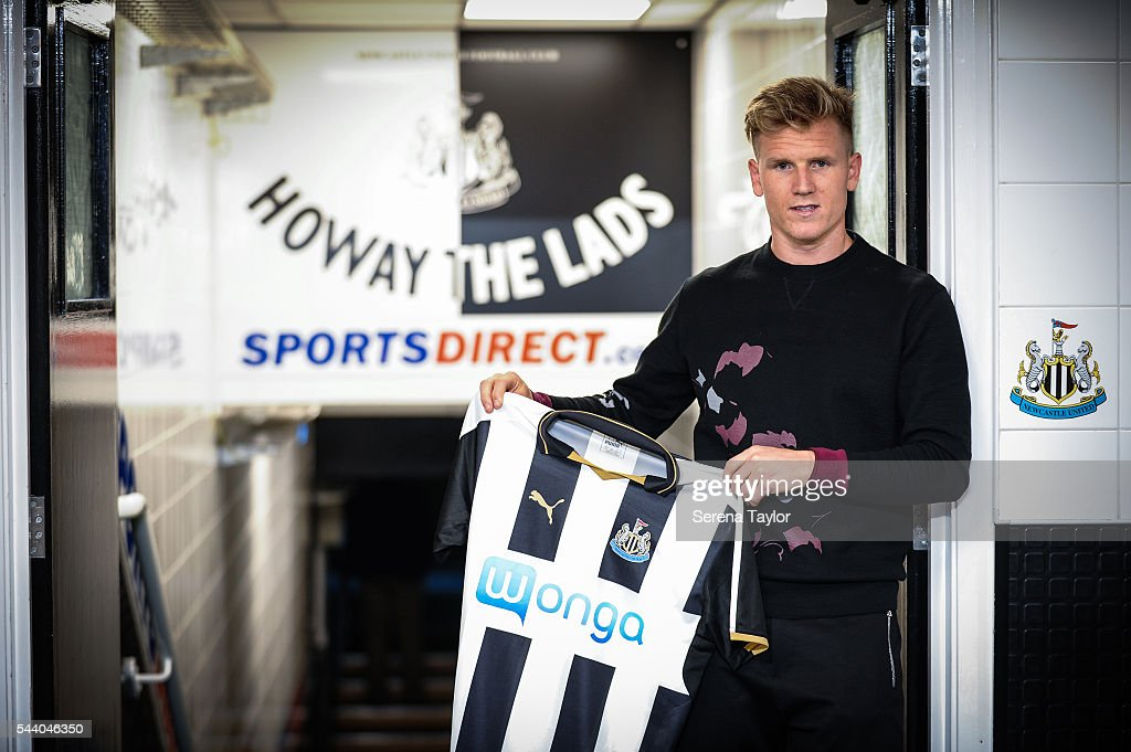New signing Matt Ritchie holds the new NUFC 2015/16 shirt in the tunnel at St.James' Park on July 1, 2016 in Newcastle upon Tyne, England.