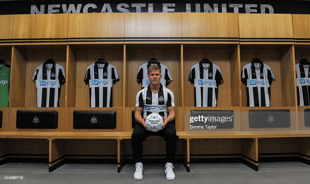 New signing Matt Ritchie poses for a photo in the home dressing room wearing the new NUFC 2015/16 shirt and holding a ball at St.James' Park on July 1, 2016 in Newcastle upon Tyne, England.