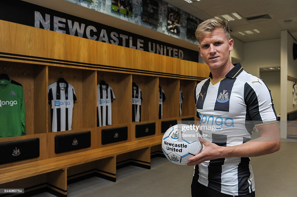New signing <a gi-track='captionPersonalityLinkClicked' href=/galleries/search?phrase=Matt+Ritchie+-+Soccer+Player&family=editorial&specificpeople=5672743 ng-click='$event.stopPropagation()'>Matt Ritchie</a> poses for a photo in the home dressing room wearing the new NUFC 2015/16 shirt and holding a ball at St.James' Park on July 1, 2016 in Newcastle upon Tyne, England.