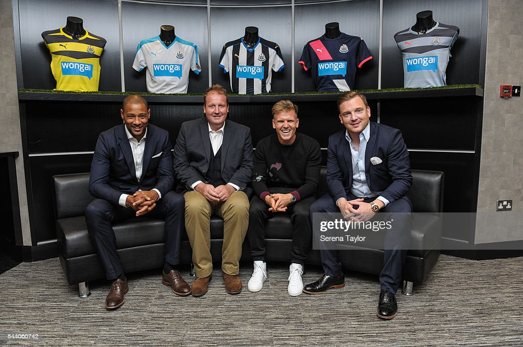 New signing <a gi-track='captionPersonalityLinkClicked' href=/galleries/search?phrase=Matt+Ritchie+-+Soccer+Player&family=editorial&specificpeople=5672743 ng-click='$event.stopPropagation()'>Matt Ritchie</a> (second from right) poses for a photo with his agents in the boardroom at St.James' Park on July 1, 2016 in Newcastle upon Tyne, England.