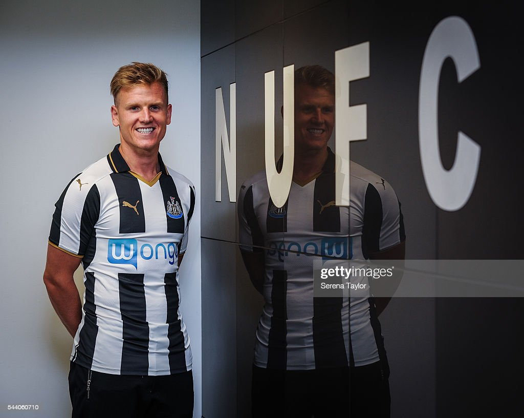 New signing Matt Ritchie poses for a photo with the NUFC sign in the home dressing room wearing the new NUFC 2015/16 shirt St.James' Park on July 1, 2016 in Newcastle upon Tyne, England.