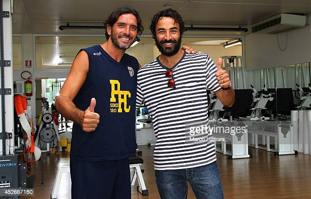 New signing Mattia Cassani and Parma FC captain Alessandro Lucarelli before FC Parma Training Session at the club's training ground on July 25 2014...