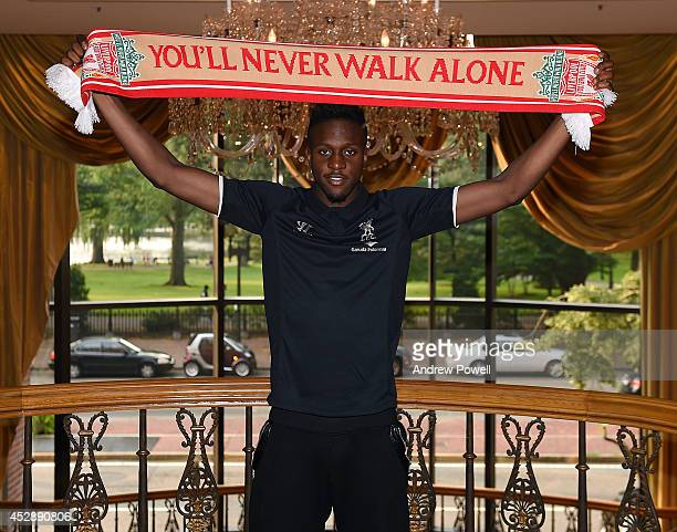 New signing of Liverpool Divock Origi poses for a photograph as he is unveiled on July 29 2014 in Boston Massachusetts