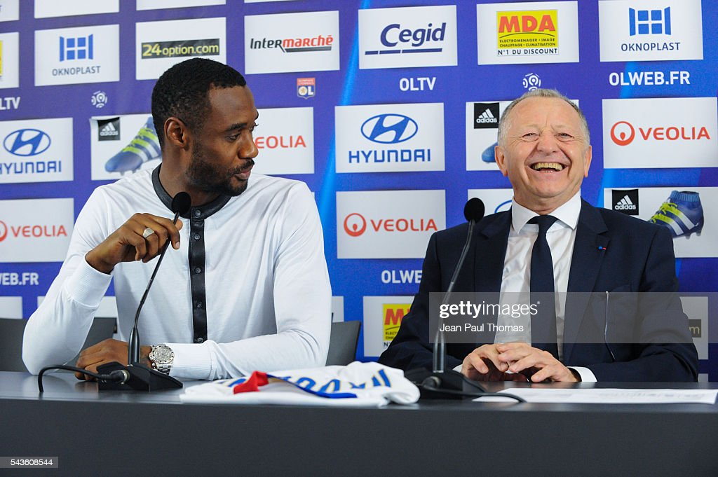 New signing player of Olympique Lyonnais Nicolas Nkoulou and president Jean Michel Aulas during press conference on June 29, 2016 in Lyon, France.